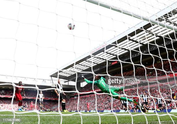 Sadio Mane of Liverpool scores his team's first goal past Martin Dubravka of Newcastle United during the Premier League match between Liverpool FC...