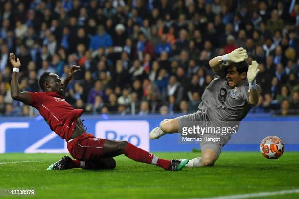 Sadio Mane of Liverpool scores his team's first goal under pressure from Iker Casillas of FC Porto during the UEFA Champions League Quarter Final...