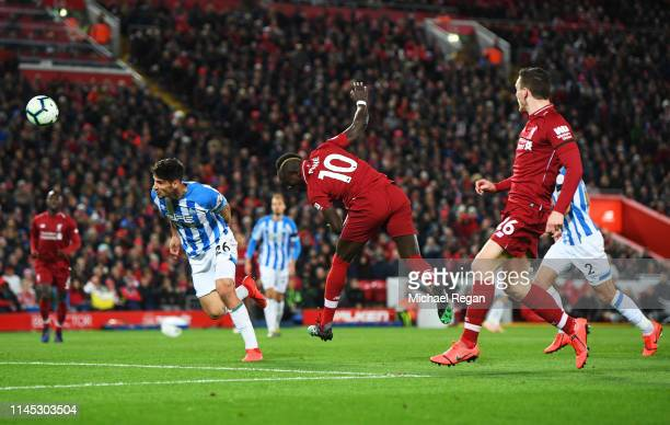 Sadio Mane of Liverpool scores his team's fourth goal during the Premier League match between Liverpool FC and Huddersfield Town at Anfield on April...
