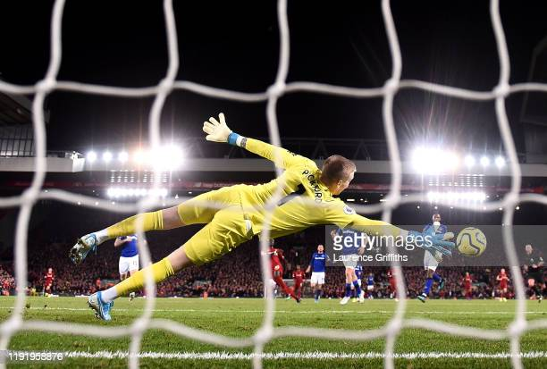 Sadio Mane of Liverpool scores his team's fourth goal past Jordan Pickford of Everton during the Premier League match between Liverpool FC and...