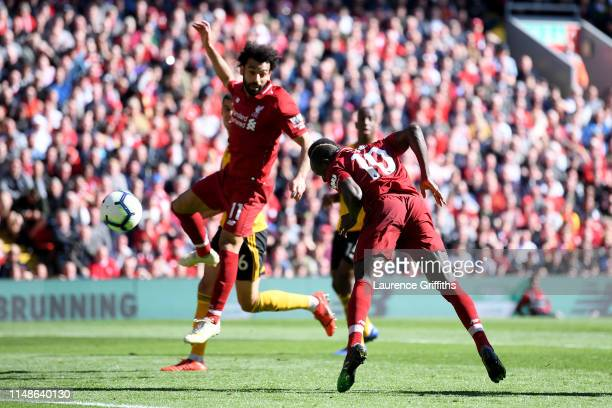 Sadio Mane of Liverpool scores his team's second goal during the Premier League match between Liverpool FC and Wolverhampton Wanderers at Anfield on...