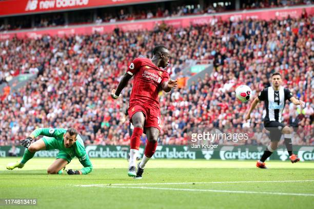 Sadio Mane of Liverpool scores his team's second goal during the Premier League match between Liverpool FC and Newcastle United at Anfield on...