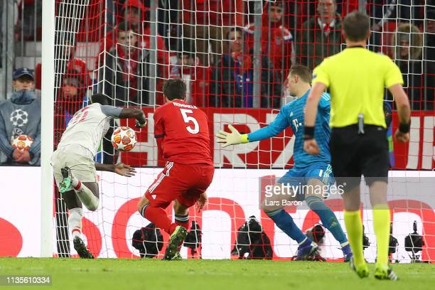 Sadio Mane of Liverpool scores his team's third goal during the UEFA Champions League Round of 16 Second Leg match between FC Bayern Muenchen and...