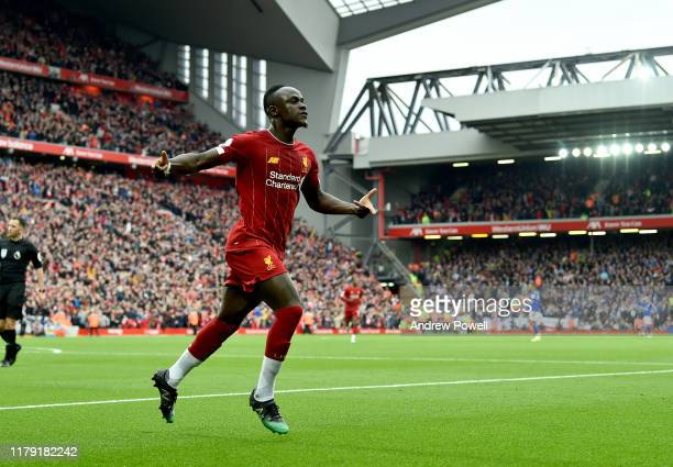 Sadio Mane of Liverpool scores the first goal and Celebrates during the Premier League match between Liverpool FC and Leicester City at Anfield on...