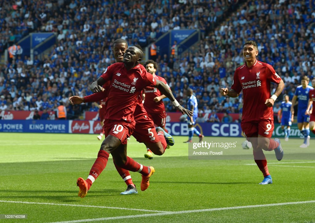 Sadio Mane of Liverpool scores the opener and celebrates during the Premier League match between Leicester City and Liverpool FC at The King Power Stadium on September 1, 2018 in Leicester, United Kingdom.