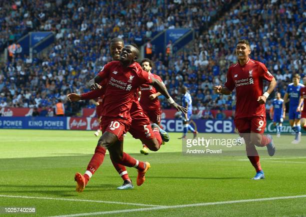 Sadio Mane of Liverpool scores the opener and celebrates during the Premier League match between Leicester City and Liverpool FC at The King Power...