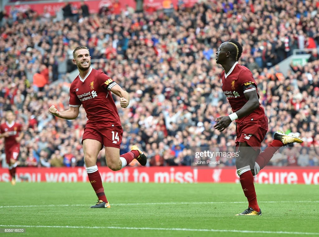 Sadio Mane of Liverpool scores The Opener and Celebrates during the Premier League match between Liverpool and Crystal Palace at Anfield on August 19, 2017 in Liverpool, England.