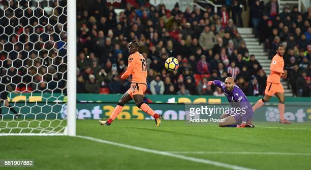 Sadio Mane of Liverpool Scores the Opener during the Premier League match between Stoke City and Liverpool at Bet365 Stadium on November 29, 2017 in...