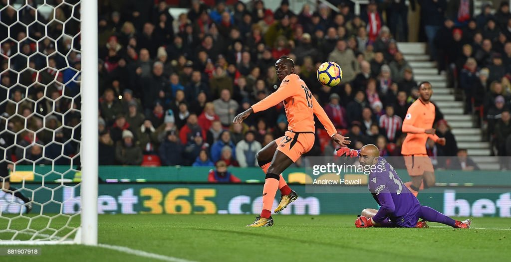 Sadio Mane of Liverpool Scores the Opener during the Premier League match between Stoke City and Liverpool at Bet365 Stadium on November 29, 2017 in Stoke on Trent, England.