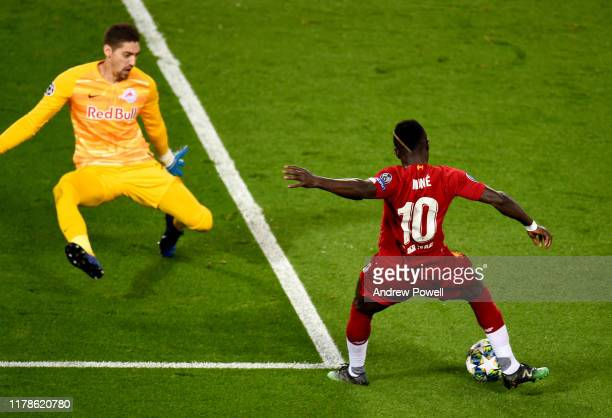 Sadio Mane of Liverpool scores the opener during the UEFA Champions League group E match between Liverpool FC and RB Salzburg at Anfield on October...