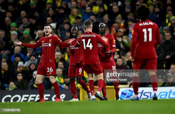 Sadio Mane of Liverpool scores the opening goal celebrates after scoring the opening goal during the Premier League match between Norwich City and...