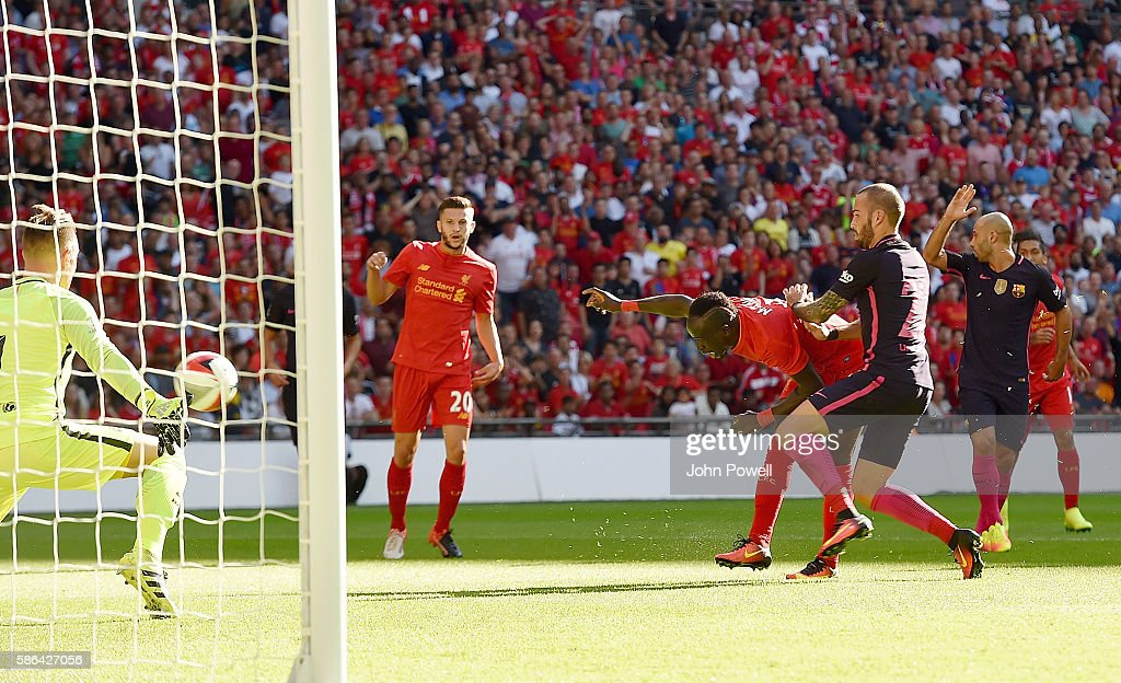 Sadio Mane of Liverpool scores the opening goal during the International Champions Cup match between Liverpool and Barcelona at Wembley Stadium on August 6, 2016 in London, England.