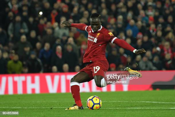 Sadio Mane of Liverpool scores the third Liverpool goal during the Premier League match between Liverpool and Manchester City at Anfield on January...