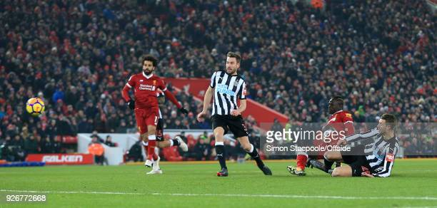 Sadio Mane of Liverpool scores their 2nd goal during the Premier League match between Liverpool and Newcastle United at Anfield on March 3 2018 in...