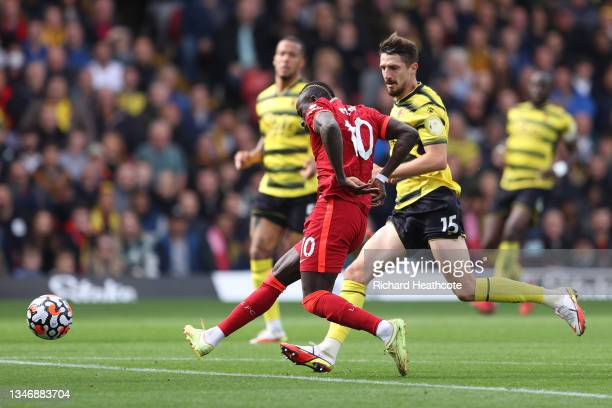 Sadio Mane of Liverpool scores their side's first goal during the Premier League match between Watford and Liverpool at Vicarage Road on October 16,...