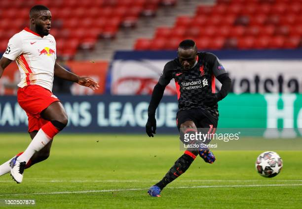 Sadio Mane of Liverpool scores their side's second goal whilst under pressure from Dayot Upamecano of RB Leipzig during the UEFA Champions League...