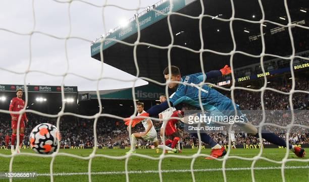 Sadio Mane of Liverpool scores their side's third goal past Illan Meslier of Leeds United during the Premier League match between Leeds United and...