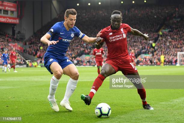Sadio Mane of Liverpool shields the ball from Cesar Azpilicueta of Chelsea during the Premier League match between Liverpool FC and Chelsea FC at...