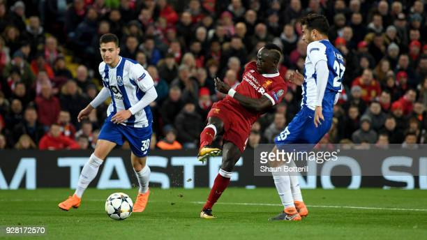 Sadio Mane of Liverpool shoots while under pressure from Diogo Dalot of FC Porto and Diego Reyes of FC Porto during the UEFA Champions League Round...