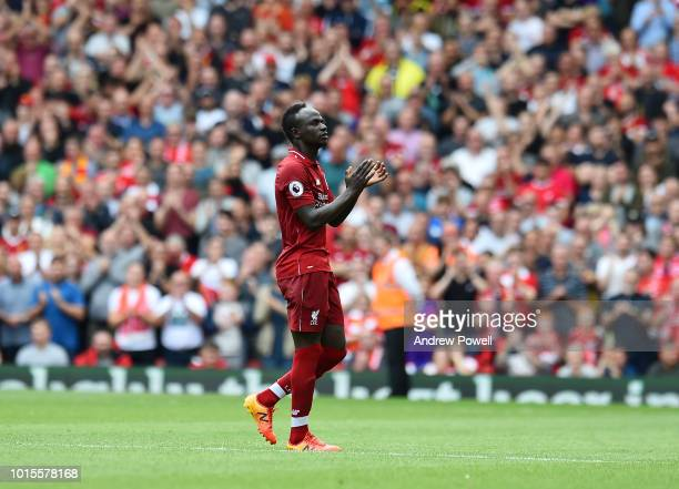 Sadio Mane of Liverpool shows his appreciation to the fans as he is substituted during the Premier League match between Liverpool FC and West Ham...