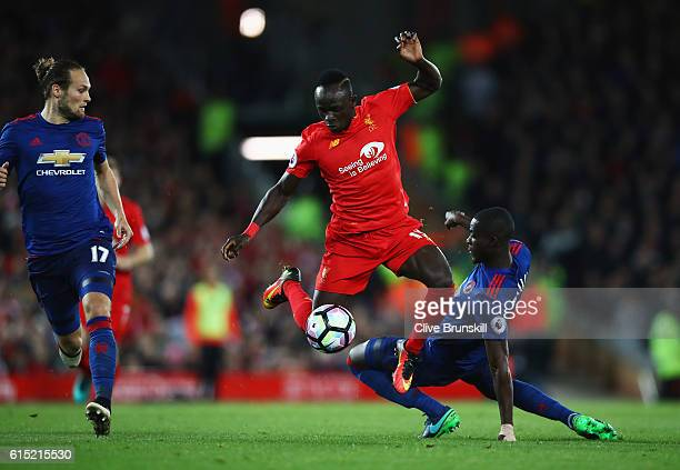 Sadio Mane of Liverpool skips past Eric Bailly of Manchester United during the Premier League match between Liverpool and Manchester United at...