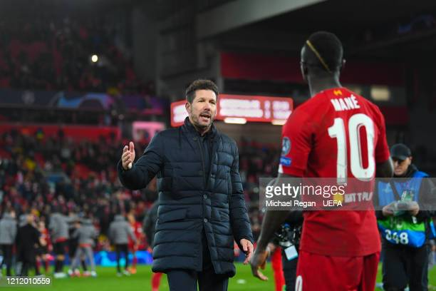 Sadio Mane of Liverpool speaks to Atletico Madrid manager Diego Simeone after the UEFA Champions League round of 16 second leg match between...