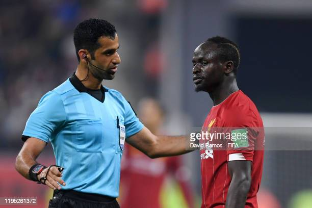 Sadio Mane of Liverpool speaks to match referee Abdulrahman AlJassim during the FIFA Club World Cup Qatar 2019 Final match between Liverpool FC and...