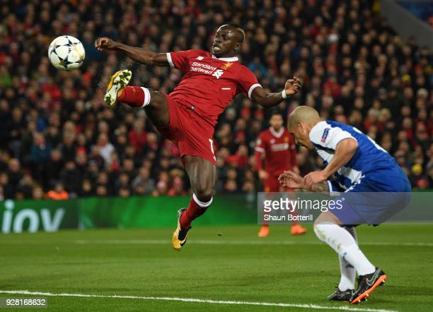 Sadio Mane of Liverpool stretches for the ball while under pressure from Maximiliano of FC Porto during the UEFA Champions League Round of 16 Second...