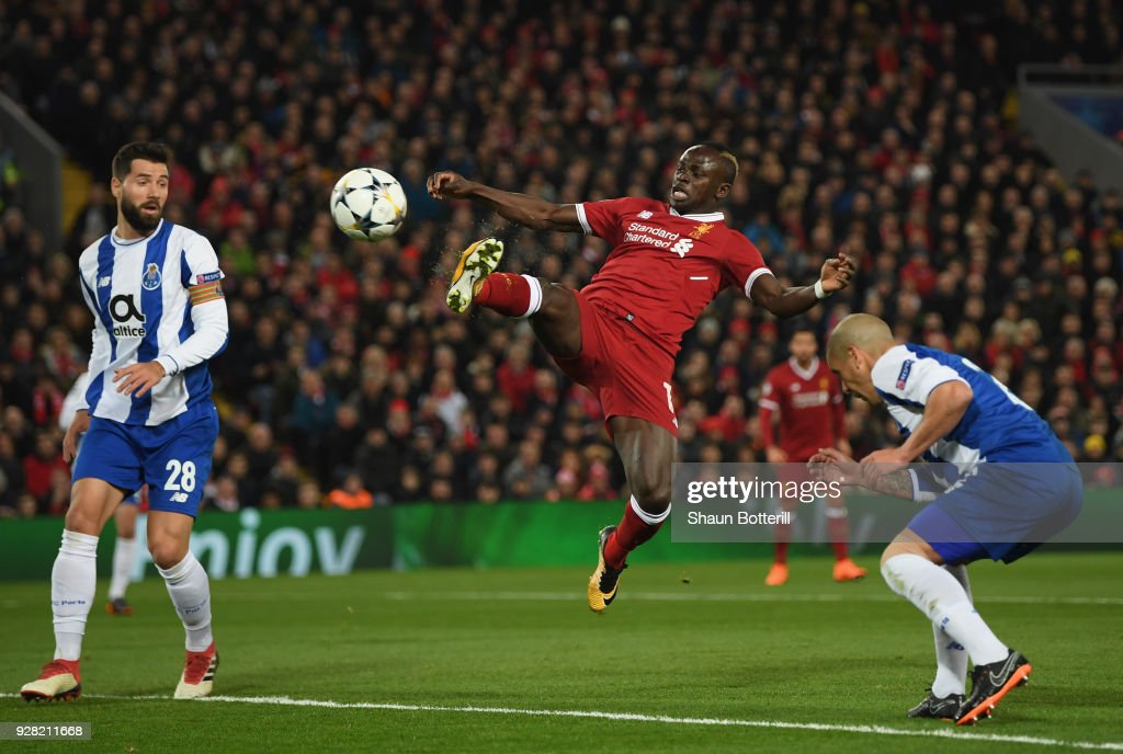 Sadio Mane of Liverpool stretches for the ball while under pressure from Maximiliano of FC Porto during the UEFA Champions League Round of 16 second leg match between Liverpool and FC Porto at Anfield on March 6, 2018 in Liverpool, United Kingdom.