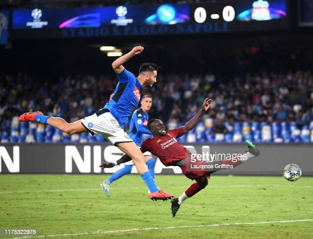 Sadio Mane of Liverpool stretches for the ball with Konstantinos Manolas of Napoli during the UEFA Champions League group E match between SSC Napoli...