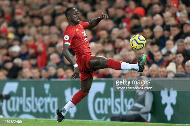 Sadio Mane of Liverpool stretches to control the ball during the Premier League match between Liverpool FC and Tottenham Hotspur at Anfield on...