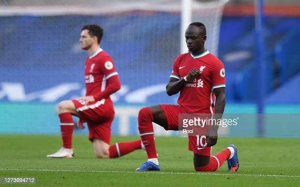 Sadio Mane of Liverpool takes a knee in support of the Black Lives Matter Movement prior to the Premier League match between Chelsea and Liverpool at...