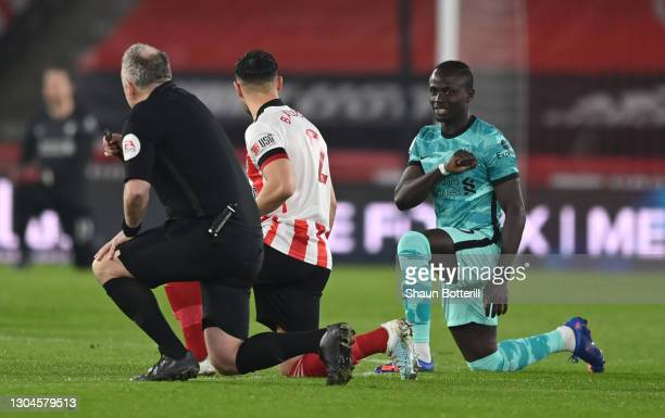Sadio Mane of Liverpool takes a knee in support of the Black Lives Matter movement prior to the Premier League match between Sheffield United and...