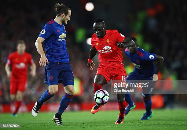 Sadio Mane of Liverpool takes on Daley Blind of Manchester United during the Premier League match between Liverpool and Manchester United at Anfield...