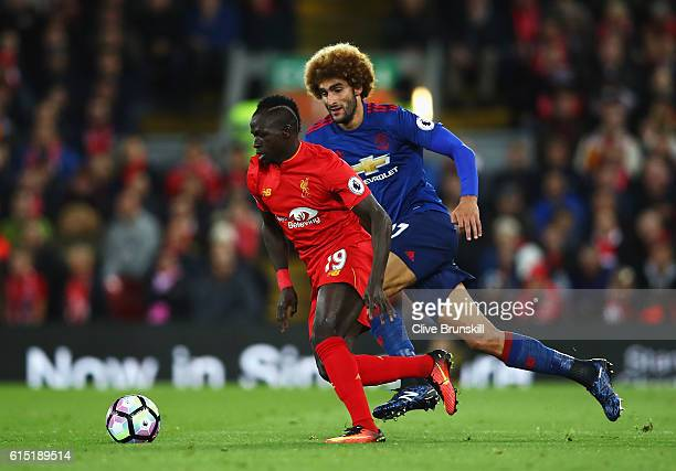 Sadio Mane of Liverpool takes on Marouane Fellaini of Manchester United during the Premier League match between Liverpool and Manchester United at...