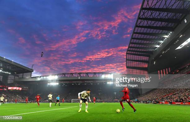 Sadio Mane of Liverpool takes on Victor Lindelof of Manchester United during the Premier League match between Liverpool FC and Manchester United at...
