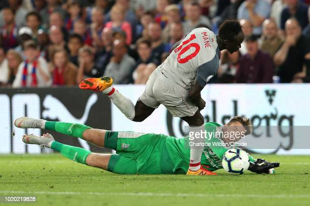 Sadio Mane of Liverpool takes the ball past Palace goalkeeper Wayne Hennessey and goes on to score the 2nd Liverpool goal during the Premier League...