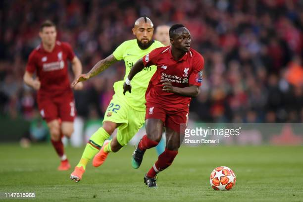Sadio Mane of Liverpool us chased by Arturo Vidal of Barcelona during the UEFA Champions League Semi Final second leg match between Liverpool and...