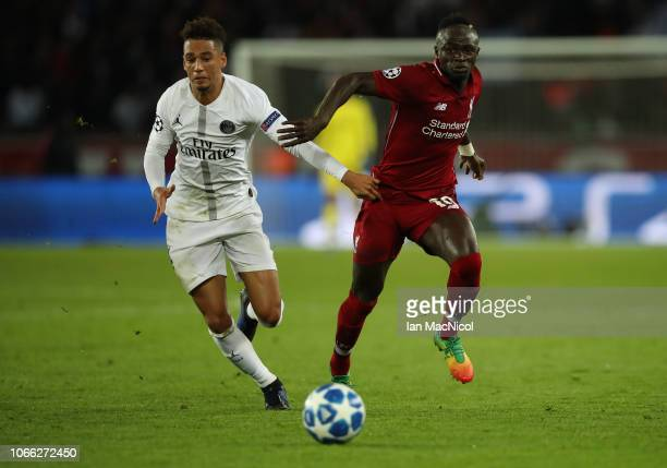 Sadio Mane of Liverpool vies with Thilo Kehrer of Paris SaintGermain during the Group C match of the UEFA Champions League between Paris SaintGermain...