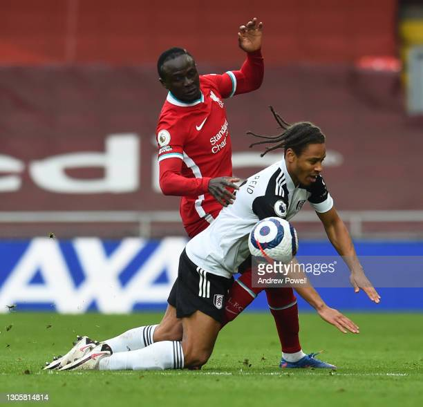 Sadio Mane of Liverpool with Bobby Decordova-Reid during the Premier League match between Liverpool and Fulham at Anfield on March 07, 2021 in...