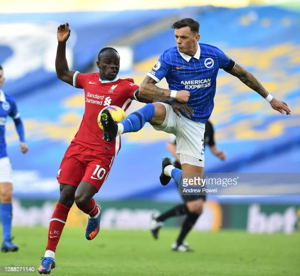 Sadio Mane of Liverpool with Brighton & Hove Albion's Ben White during the Premier League match between Brighton & Hove Albion and Liverpool at...