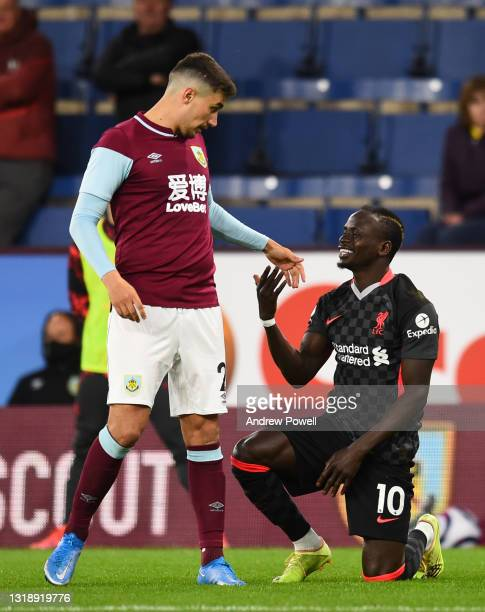 Sadio Mane of Liverpool with Burnley's Matthew Lowton during the Premier League match between Burnley and Liverpool at Turf Moor on May 19, 2021 in...