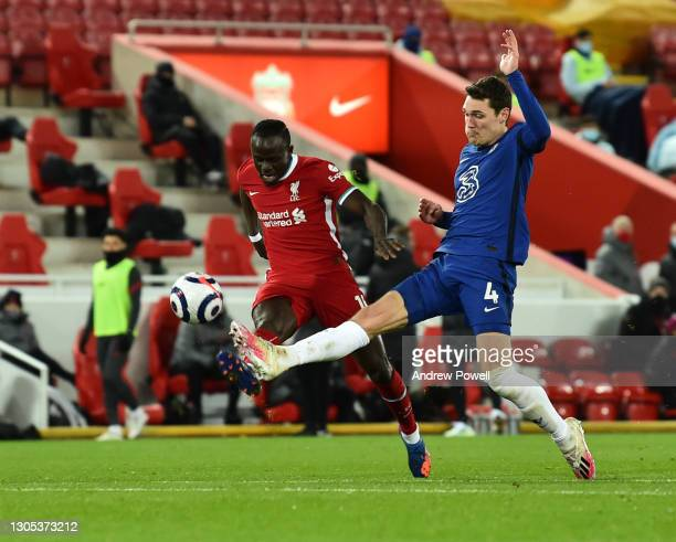 Sadio Mane of Liverpool with Chelsea's Andreas Christensen during the Premier League match between Liverpool and Chelsea at Anfield on March 04, 2021...