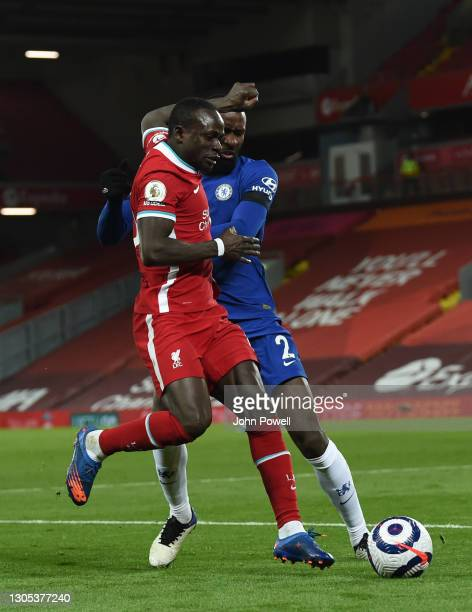 Sadio Mane of Liverpool with Chelsea's Antonio Rudiger during the Premier League match between Liverpool and Chelsea at Anfield on March 04, 2021 in...