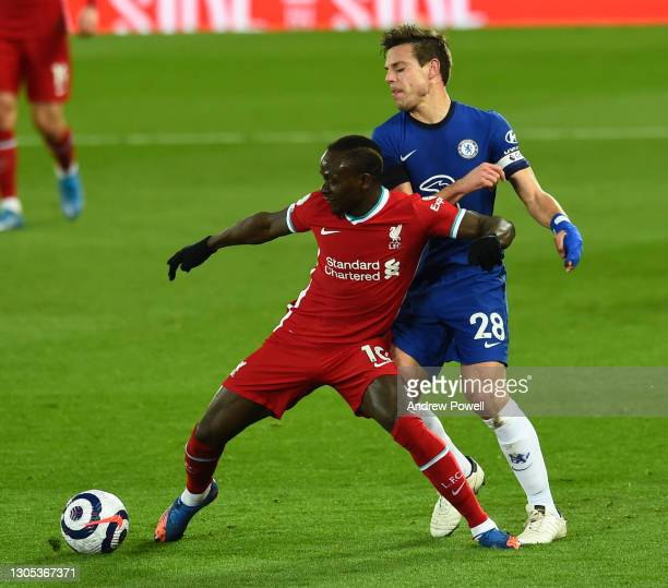 Sadio Mane of Liverpool with Chelsea's Cesar Azpilicueta during the Premier League match between Liverpool and Chelsea at Anfield on March 04, 2021...