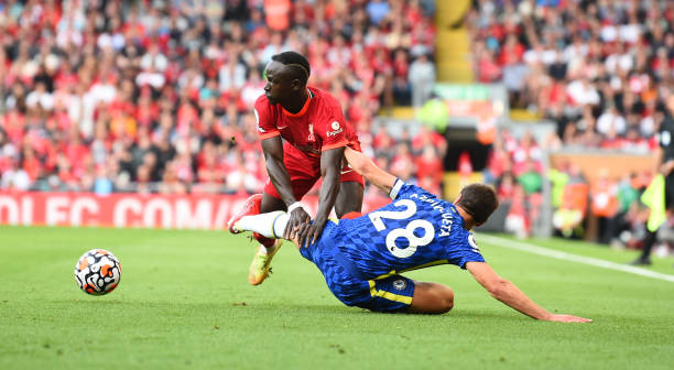 Sadio Mane of Liverpool with Chelsea's Cesar Azpilicueta during the Premier League match between Liverpool and Chelsea at Anfield on August 28, 2021...