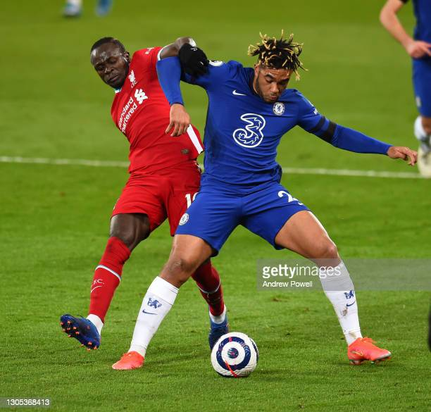 Sadio Mane of Liverpool with Chelsea's Reece James during the Premier League match between Liverpool and Chelsea at Anfield on March 04, 2021 in...