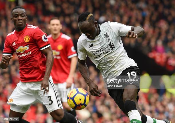 Sadio Mane of Liverpool with Eric Bailly of Man Utd during the Premier League match between Manchester United and Liverpool at Old Trafford on March...