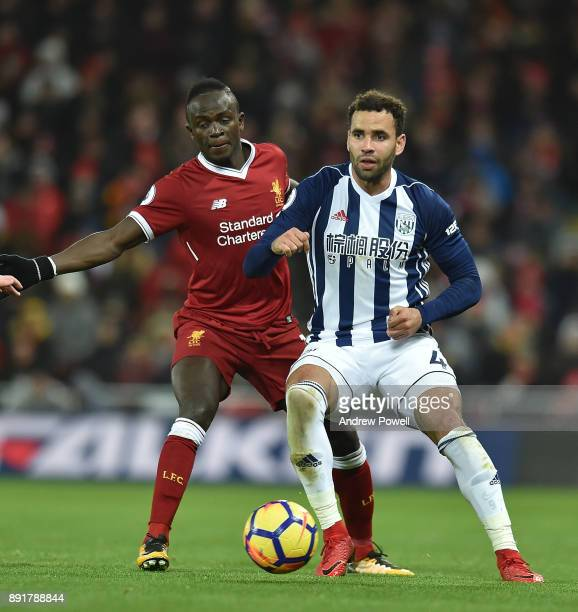 Sadio Mane of Liverpool with Hal RobsonKanu of West Brom during the Premier League match between Liverpool and West Bromwich Albion at Anfield on...