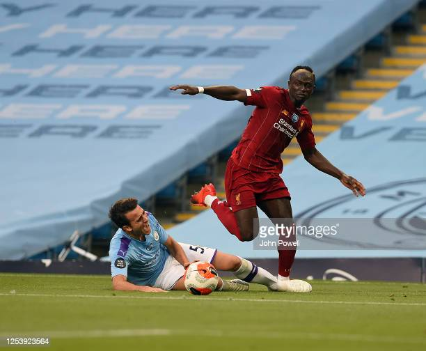 Sadio Mane of Liverpool with Manchester Citys Eric Garcia during the Premier League match between Manchester City and Liverpool FC at Etihad Stadium...